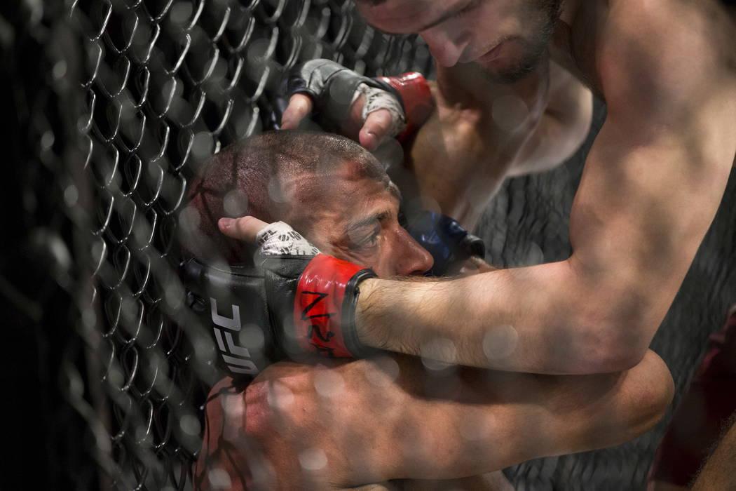 Edson Barboza, left, battles Khabib Nurmagomedov in the lightweight bout at T-Mobile Arena in Las Vegas, Saturday, Dec. 30, 2017. Nurmagomedov won by unanimous decision. Erik Verduzco/Las Vegas Re ...
