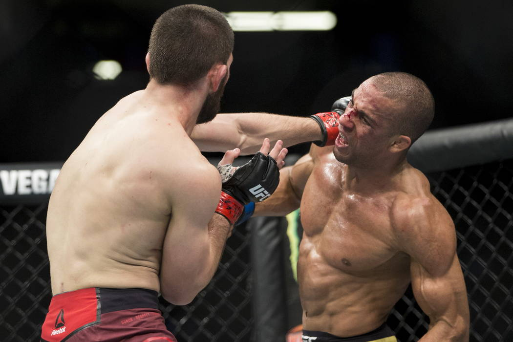 Khabib Nurmagomedov, left, battles Edson Barboza in the UFC 219 lightweight bout at T-Mobile Arena in Las Vegas, Saturday, Dec. 30, 2017. Nurmagomedov won by unanimous decision. Erik Verduzco/Las  ...