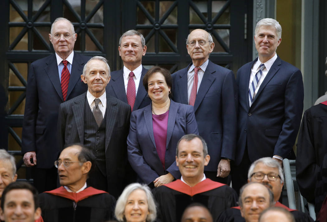 Justices of the U.S. Supreme Court, Associate Justice Elena Kagan, center right, and top row from left, Associate Justice Anthony Kennedy, Chief Justice John Roberts, Associate Justice Stephen Bre ...