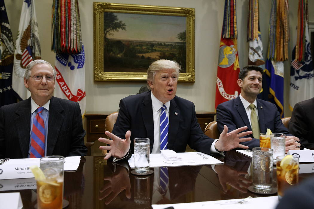 FILE - In this March 1, 2017 file photo, President Donald Trump, flanked by Senate Majority Leader Mitch McConnell of Ky., left, and House Speaker Paul Ryan of Wis., speaks during a meeting with H ...