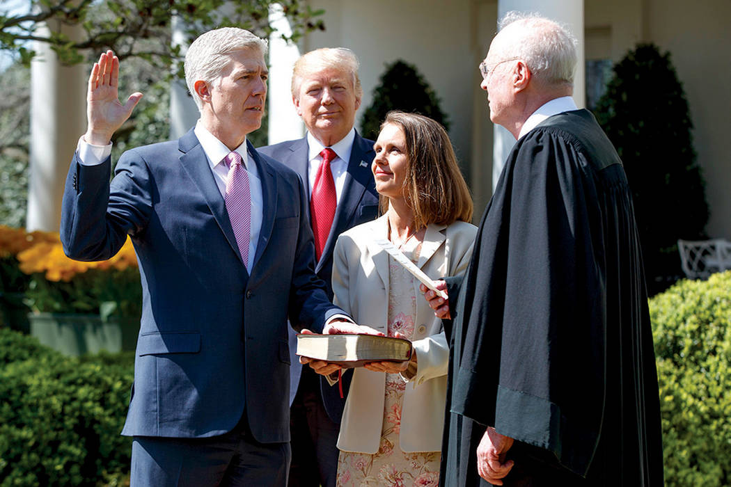 Judge Neil Gorsuch is sworn in as an associate justice of the Supreme Court by Supreme Court Associate Justice Anthony Kennedy as President Donald J. Trump watches with Louise Gorsuch in the Rose  ...