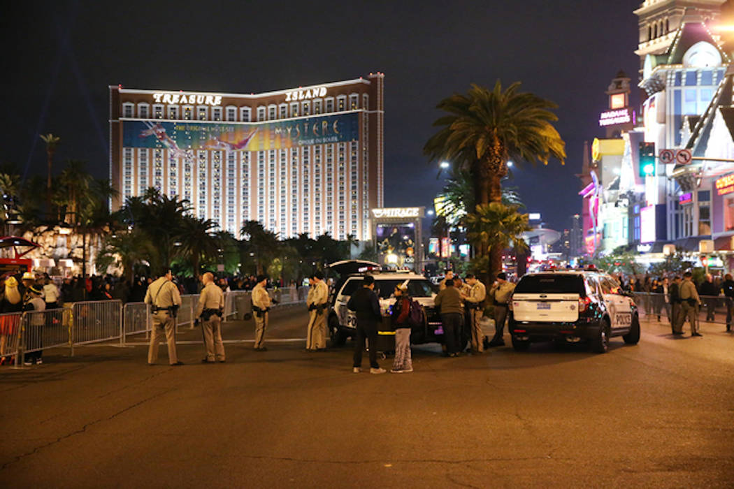 Las Vegas police officer monitor the Strip near The Mirage hotel-casino on New Year's Eve, Saturday, Dec. 31, 2016. (Erik Verduzco/Las Vegas Review-Journal)