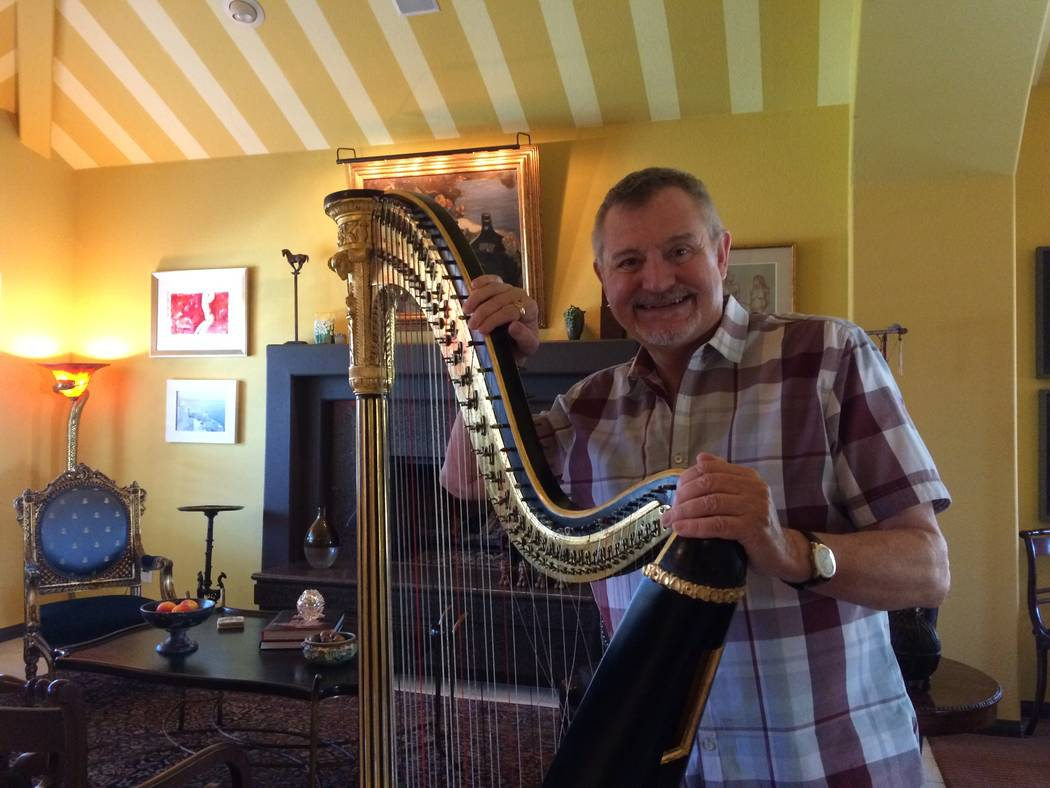 Dumont  poses in his home with his showcase piece, an 1809 single-action harp, a predecessor to the modern harp. It was reportedly made by Jean-Henri Naderman, harp maker for Marie Antoinette. (Ja ...