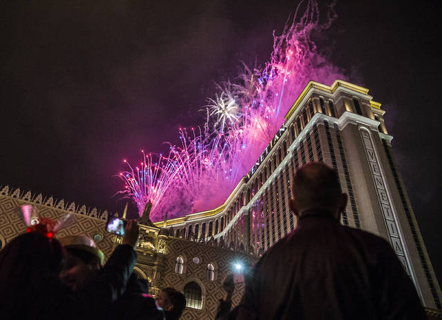 new years eve party goers watch the fireworks outside the venetian hotel casino on the