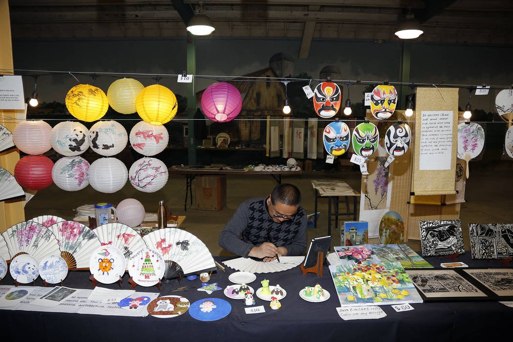 A portrait of an artisan designing fans at the China Lights Festival. (Blaire Ritter)