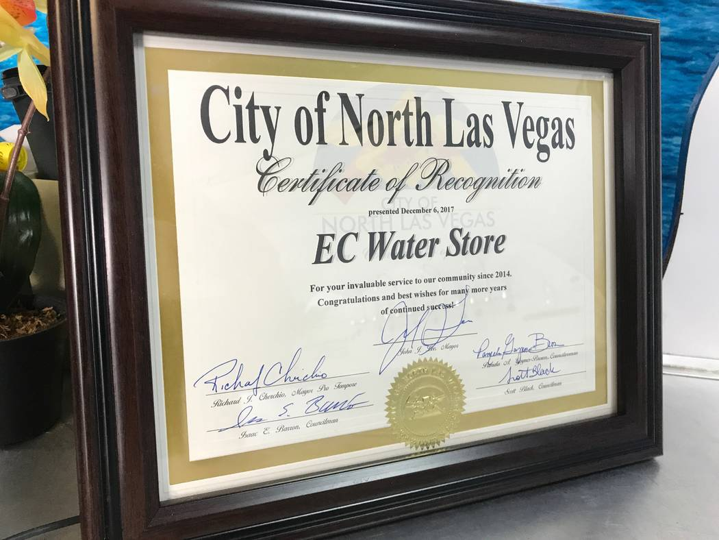 The plaque EC Water Store owner Steve Meunier was given for business of the month is displayed on Dec. 26, 2017 at the store, 2696 W. Ann Road #110. (Kailyn Brown/View) @KailynHype