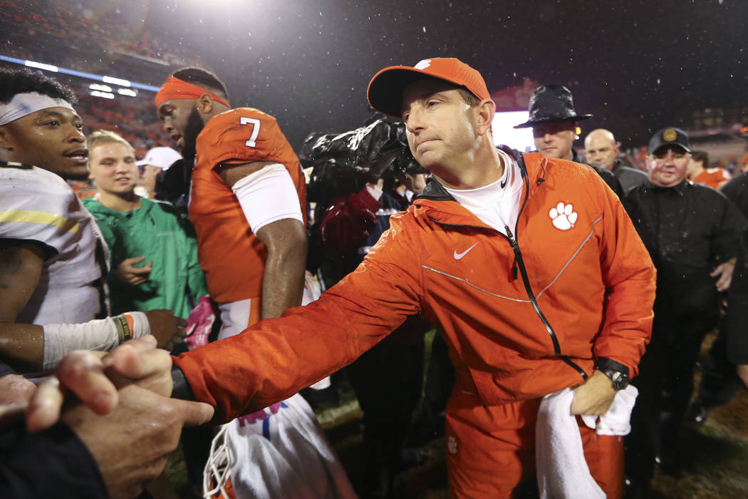 Clemson head coach Dabo Swinney greets fans after defeating Georgia Tech in an NCAA college football game Saturday, Oct. 28, 2017, in Clemson, S.C. (Clemson won 24-10. AP Photo/John Bazemore)