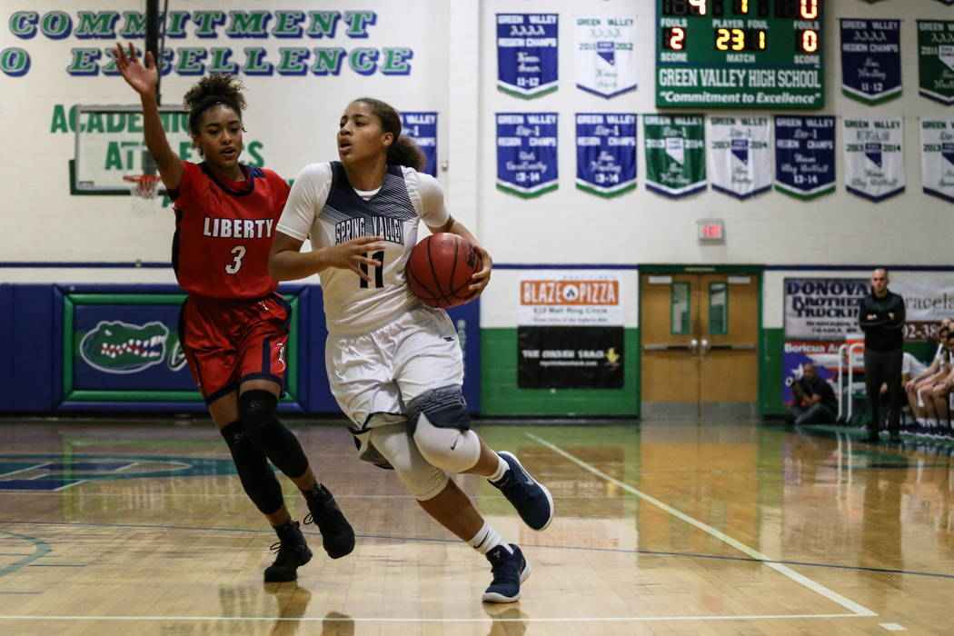 Liberty's Journie Augmon (3) guards Spring Valley's Kayla Harris (11) during the first quarter of the championship basketball game of the diamond bracket in the Gator Winter Classic at Gree ...