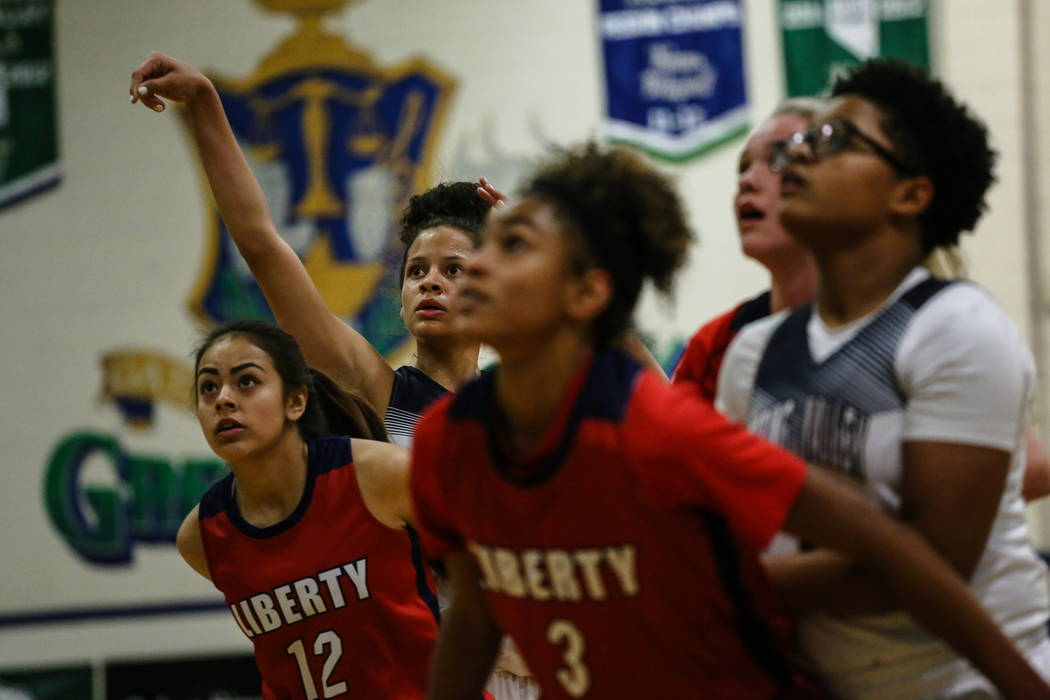 Spring Valley's Essence Booker (3), second from left, shoots a free-throw during the first quarter of the championship basketball game of the diamond bracket against Liberty in the Gator Wi ...