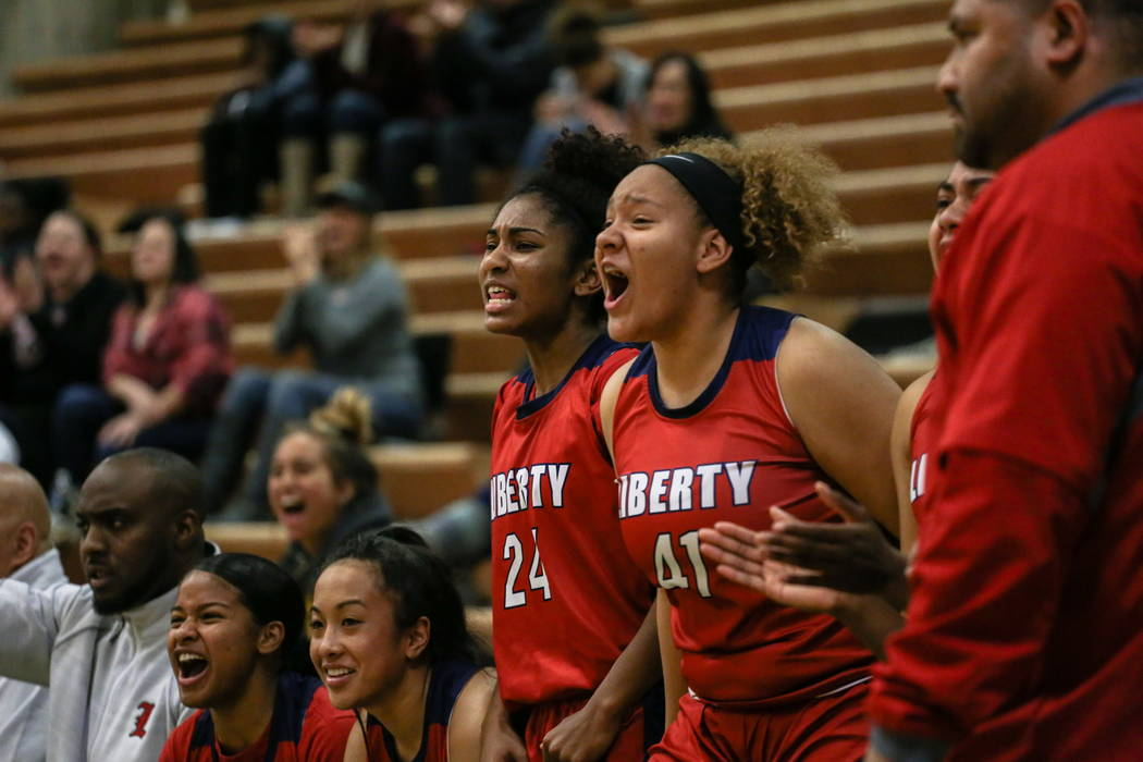 Liberty's Trinity Vasquez (24) and Alexss Parker (41) cheer during the fourth quarter of the championship basketball game of the diamond bracket against Spring Valley in the Gator Winter Classic a ...