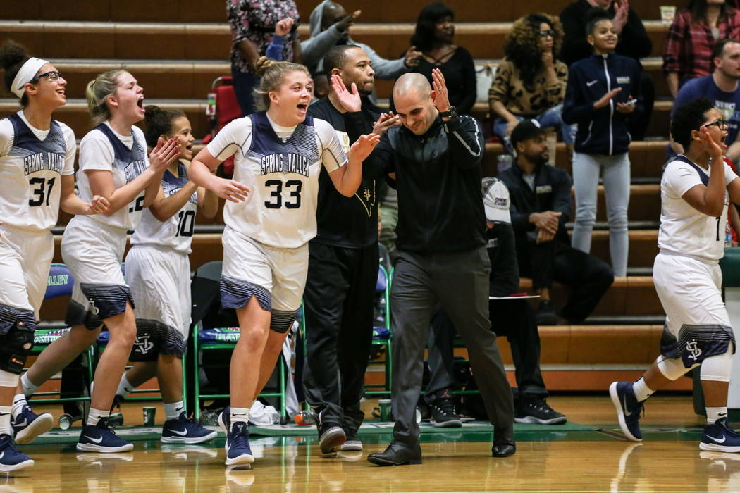 Spring Valley's Natalie Meredith (33) and Spring Valley head coach Billy Hemberger celebrate after defeating Liberty 67-65 in the diamond bracket final of the Gator Winter Classic at Green  ...