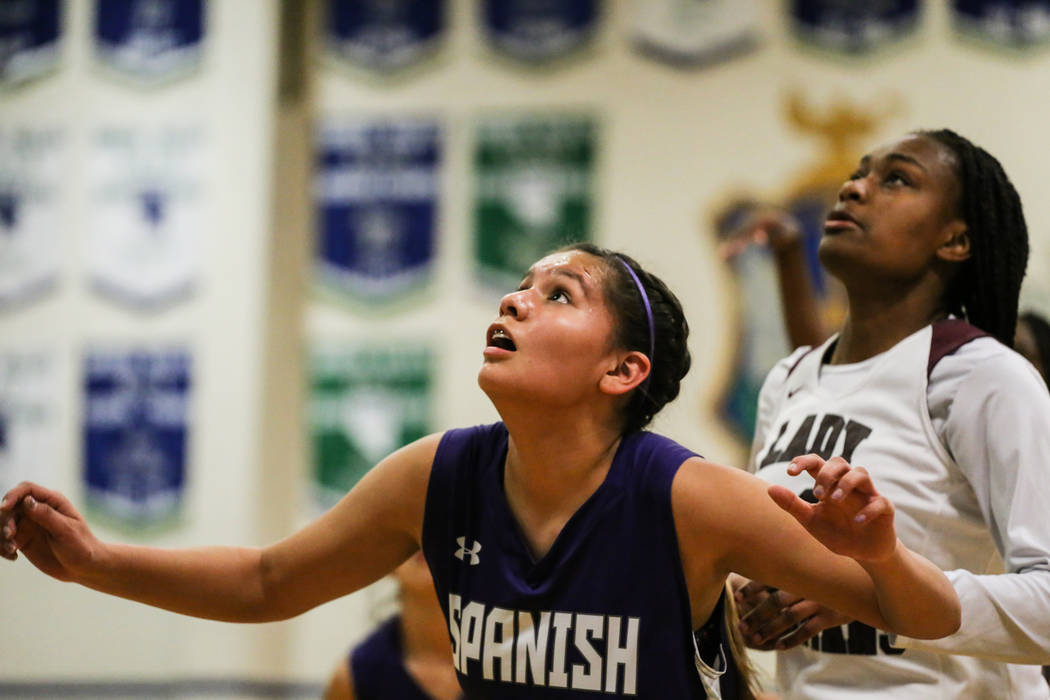 Spanish Springs' Lauryn Dressler (20), left, and Cimarron-Memorial's Amoura Whitney (33), right, eye a rebound during the first quarter of a basketball game during the Gator Winter Classic at Gree ...