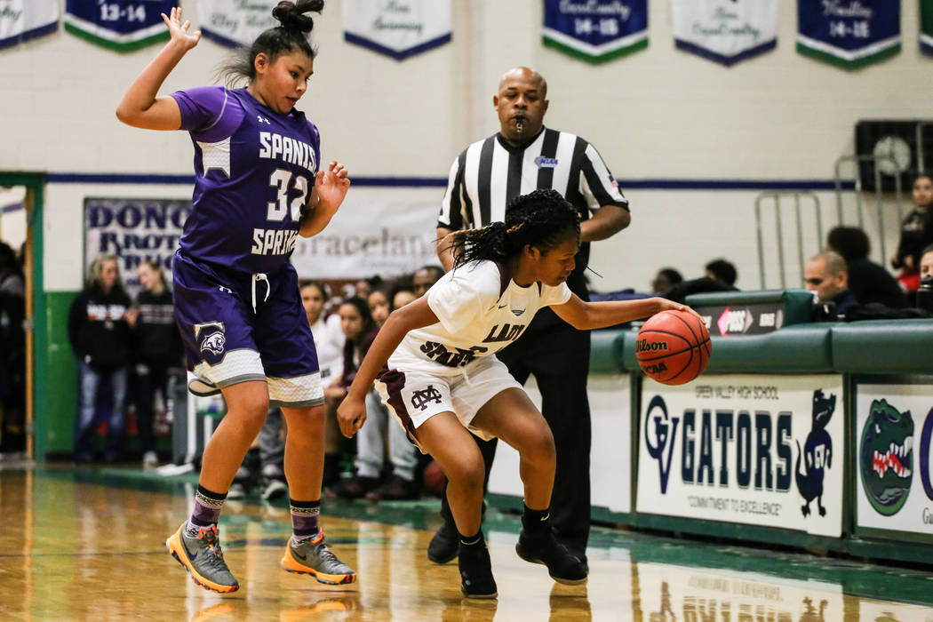 Cimarron-Memorial's Yesenia Wesley-Nash (24) dribbles the ball past Spanish Springs' Kierra Johnson (32) during the first quarter of a basketball game during the Gator Winter Classic at Green Vall ...