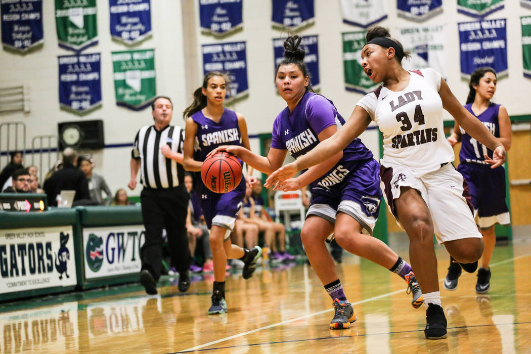 Spanish Springs' Kierra Johnson (32) dribbles the ball as she is guarded by Cimarron-Memorial's Tasia Moore (34) during the second quarter of a basketball game during the Gator Winter Classic at G ...