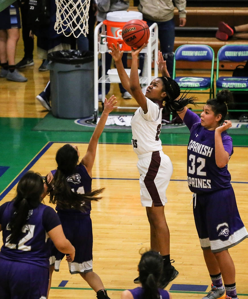 Cimarron-Memorial's Yesenia Wesley-Nash (24) shoots the ball as she is guarded by Spanish Springs' Kiyla Wadsworth (22), Spanish Springs' Naelia Pinedo (11) and Spanish Springs' Kierra Johnson (32 ...