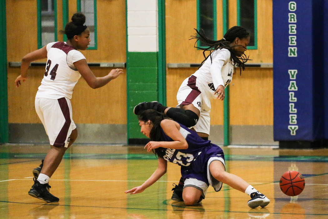 Cimarron-Memorial's Amoura Whitney (33) jumps over Spanish Springs' Serena Sanchez (23) during the third quarter of a basketball game during the Gator Winter Classic at Green Valley High School in ...
