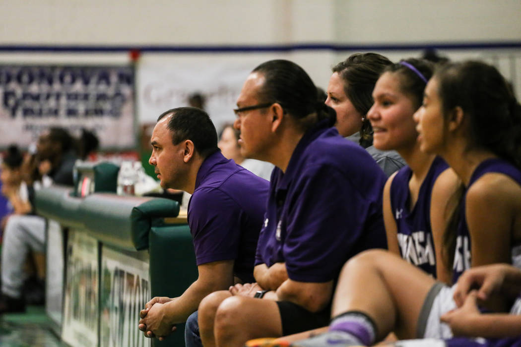 Spanish Springs head coach Arturo Cardenas, left, watches the fourth quarter of a basketball game against Cimarron-Memorial during the Gator Winter Classic at Green Valley High School in Henderson ...