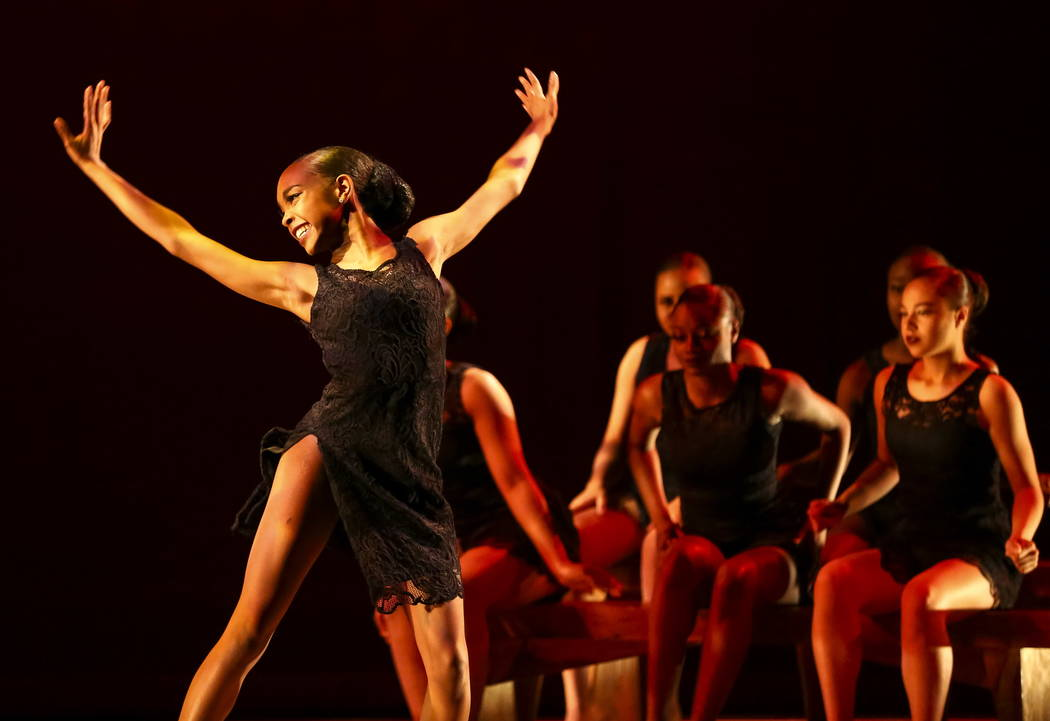 "Members of the West Las Vegas Arts Center Performance Ensemble perform a dance routine titled ""Suite Soul"" during a Kwanzaa celebration at the West Las Vegas Library Theatre on S ..."