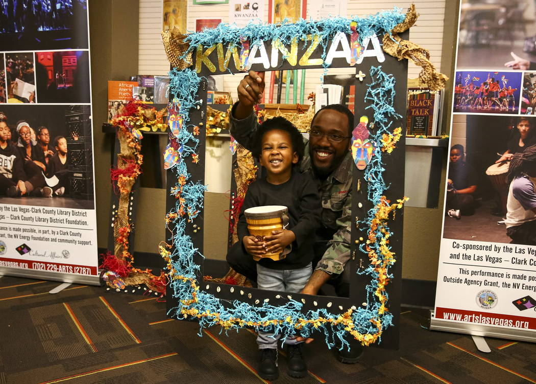 Charles Mitchell and his two-year-old son, Zahir, pose for photos during a Kwanzaa celebration at the West Las Vegas Library Theatre on Saturday, December 30, 2017. Richard Brian Las Vegas Review- ...