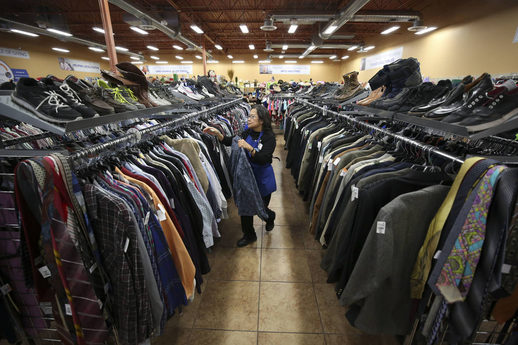 Cashier Imelda Burtless organizes items in the men's aisle at the Goodwill store located at 1390 American Pacific Drive in Henderson on Thursday, Dec. 28, 2017. Richard Brian Las Vegas Review-Jour ...
