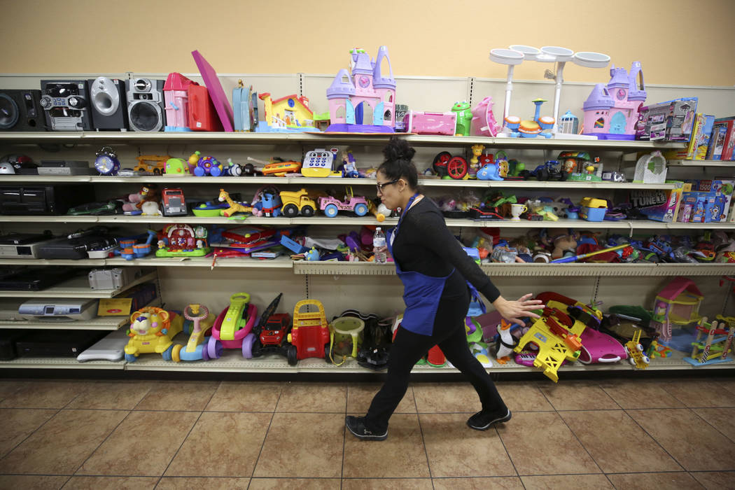 A worker walks past toys for sale at the Goodwill store located at 1390 American Pacific Drive in Henderson on Thursday, Dec. 28, 2017. Richard Brian Las Vegas Review-Journal @vegasphotograph