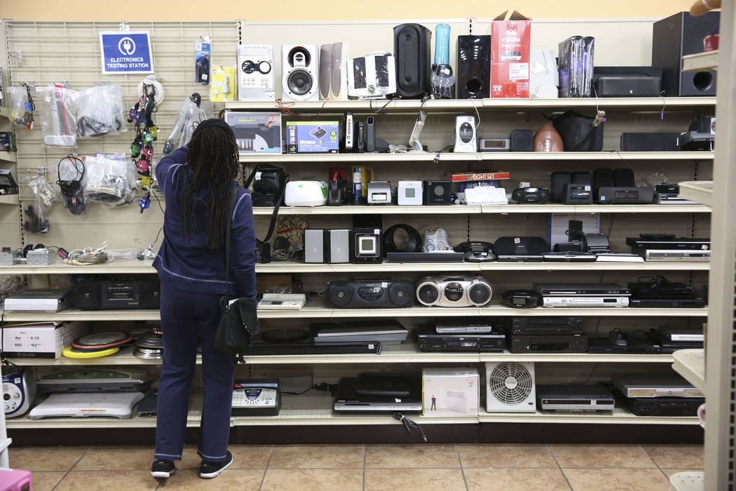 A woman browses over the second-hand electronics for sale at the Goodwill store located at 1390 American Pacific Drive in Henderson on Thursday, Dec. 28, 2017. Richard Brian Las Vegas Review-Journ ...