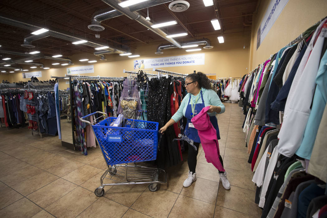 Lead Cashier Karla Diaz straightens up the aisles at the  Goodwill store located at 1390 American Pacific Drive in Henderson on Thursday, Dec. 28, 2017. Richard Brian Las Vegas Review-Journal @veg ...