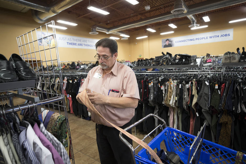 Assistant store manager Roland Sanchez organizes a tie display at the Goodwill store located at 1390 American Pacific Drive in Henderson on Thursday, Dec. 28, 2017. Richard Brian Las Vegas Review- ...