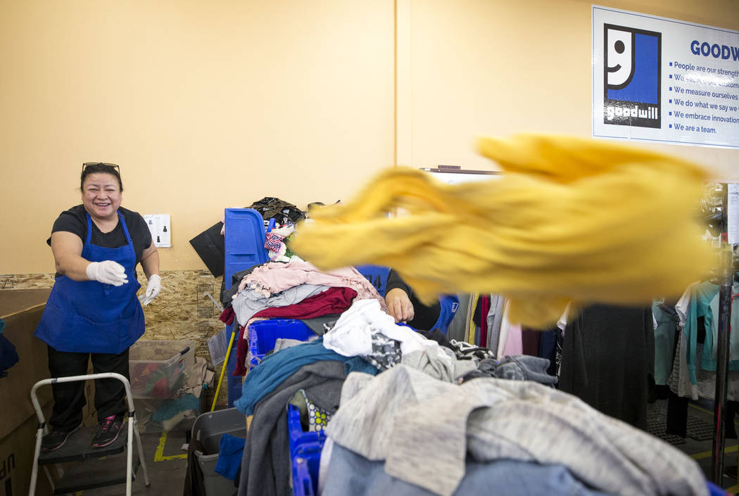Associate processor Nora Romero sorts though clothing donations at the Goodwill store located at 1390 American Pacific Drive in Henderson on Thursday, Dec. 28, 2017. Richard Brian Las Vegas Review ...