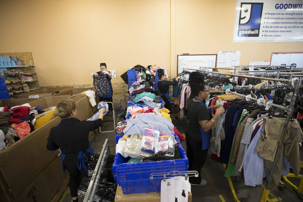 Workers sort though clothing donations at the Goodwill store located at 1390 American Pacific Drive in Henderson on Thursday, Dec. 28, 2017. Richard Brian Las Vegas Review-Journal @vegasphotograph