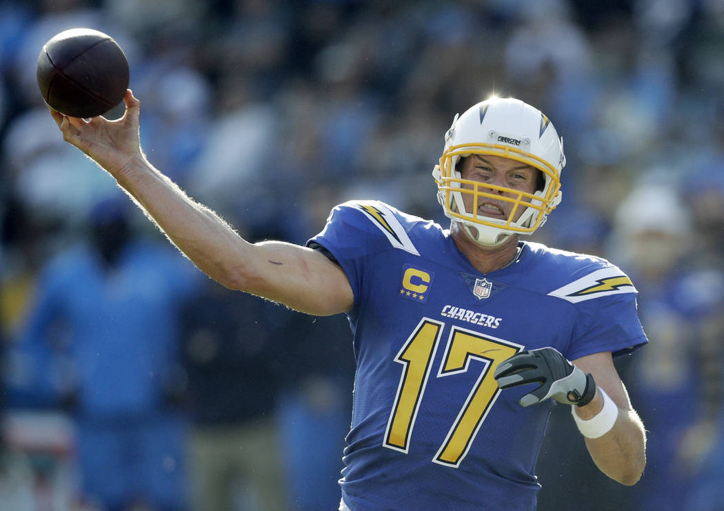 Los Angeles Chargers quarterback Philip Rivers passes against the Cleveland Browns during the first half of an NFL football game Sunday, Dec. 3, 2017, in Carson, Calif. (AP Photo/Jae C. Hong)