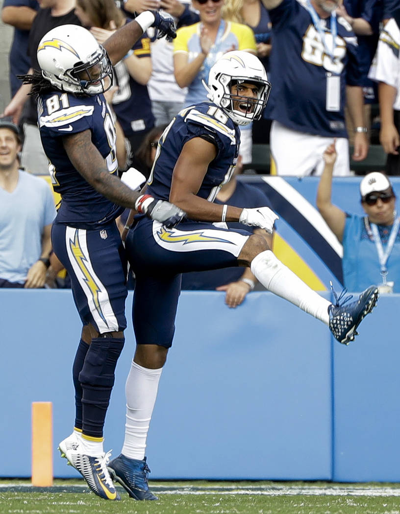 Los Angeles Chargers wide receiver Tyrell Williams, right, reacts with teammate wide receiver Mike Williams after scoring a touchdown during the first half of an NFL football game against the Wash ...