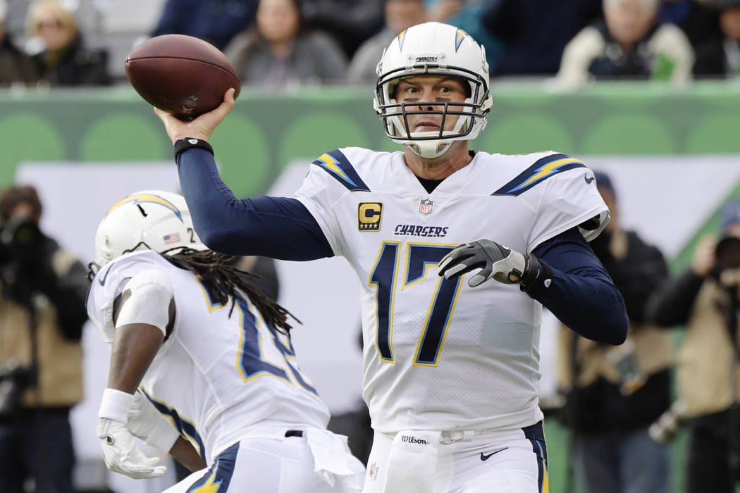 Los Angeles Chargers quarterback Philip Rivers (17) throws a pass during the first half of an NFL football game against the New York Jets, Sunday, Dec. 24, 2017, in East Rutherford, N.J. (AP Photo ...