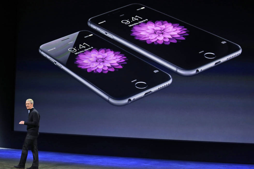 Apple CEO Tim Cook talks about the iPhone 6 and iPhone 6 Plus during an Apple event in San Francisco on March 9, 2015. (Eric Risberg/AP, File)
