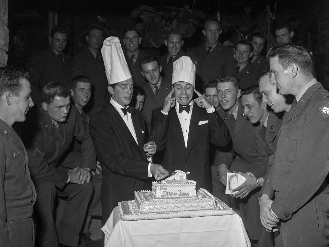 Dean Martin and Jerry Lewis clown around February 1, 1955, at the Sands in Las Vegas as they entertain troops taking part in Desert Rock exercises. The Desert Rock exercises involved troops operat ...