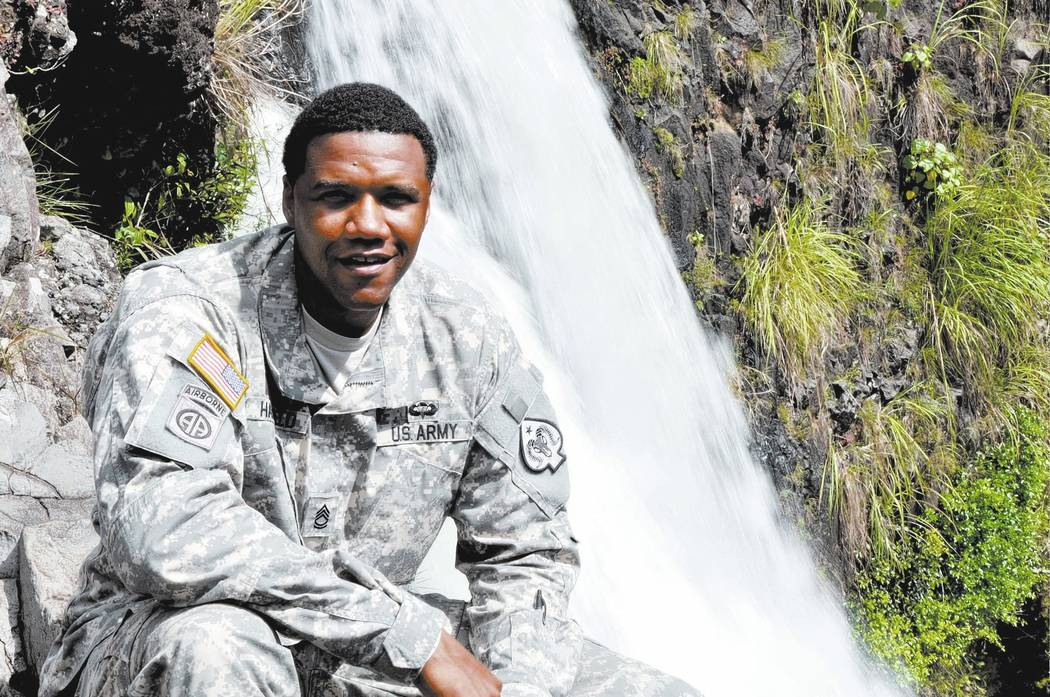 Nevada Army National Guard Sgt. 1st Class Charleston Hartfield was a victim of the shooting . In this June 6, 2015, photo, Hartfield is at Rainbow Falls near Hilo, Hawaii. (Sgt. Walter Lowell/U.S. ...