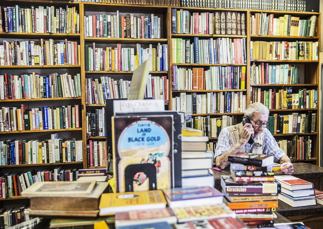 Amber Unicorn Books owner Lou Donato takes a customer order on Monday, March 20, 2017, at Amber Unicorn Books, in Las Vegas. (Benjamin Hager/Las Vegas Review-Journal) @benjaminhphoto