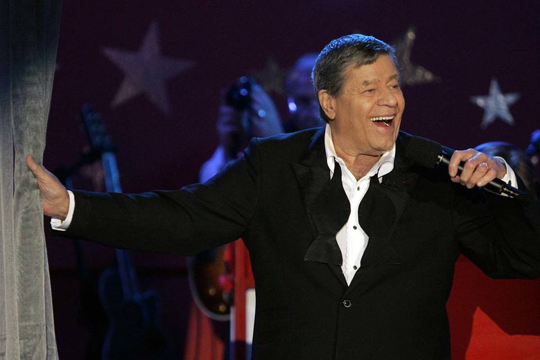 Longtime host Jerry Lewis performs during the Muscular Dystrophy Association telethon in Beverly Hills, Calif., on Sept. 5, 2005. Lewis, the comedian and director whose fundraising telethons becam ...