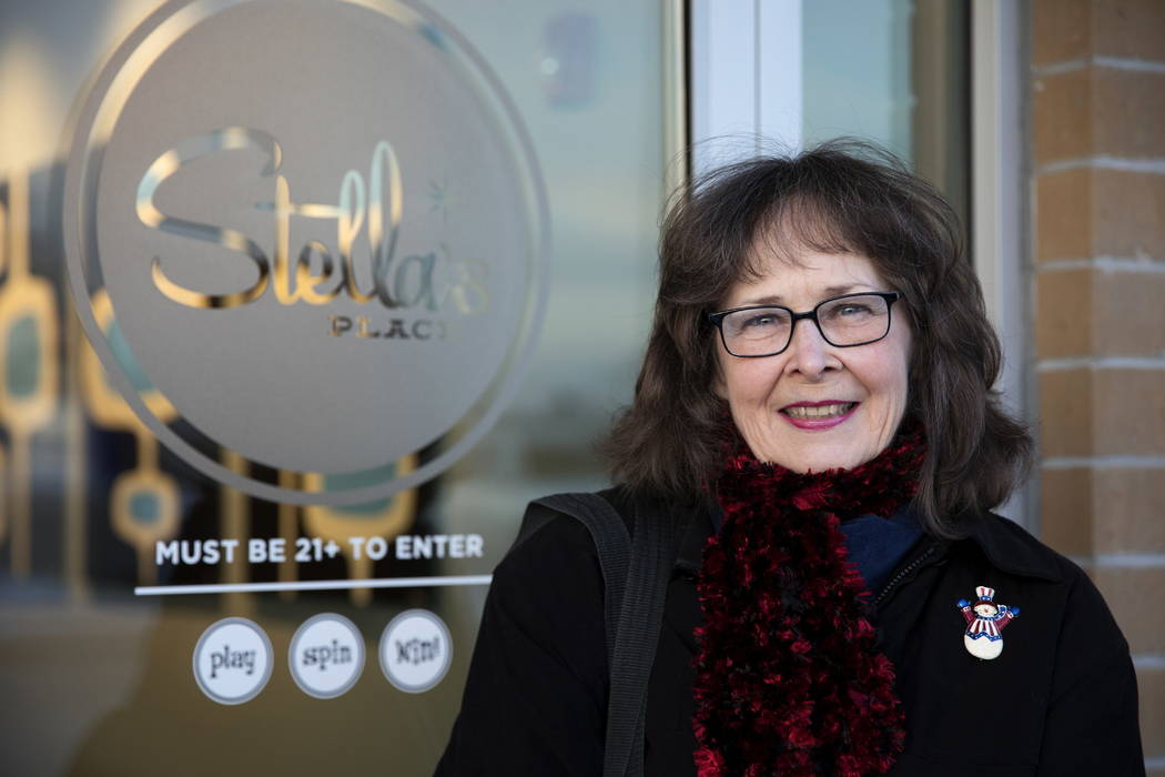 Kathy Gilroy poses for a photo in Villa Park, Ill. She entered a free sweepstakes and won $25,000 through a gambling parlor in Villa Park, Ill. (Erin Hooley/Chicago Tribune via AP)