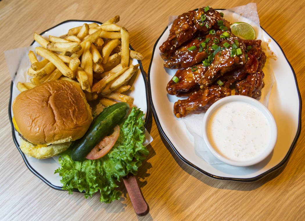 The All American Burger Next To Spicy Korean Bbq Wings With Buttermilk Dill Dressing