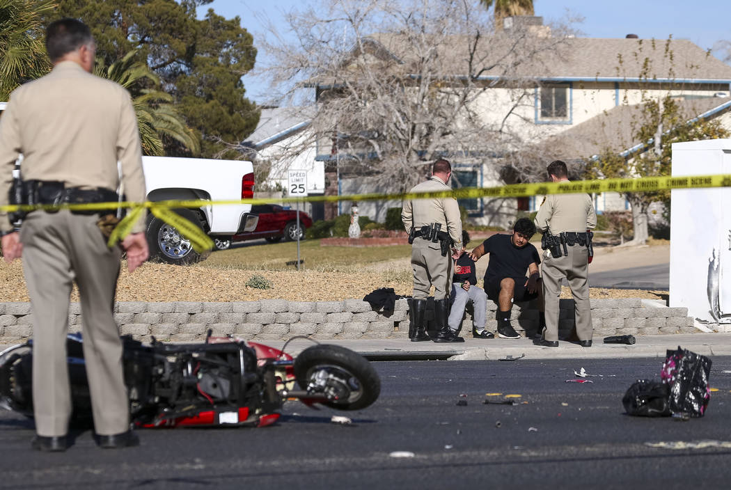 Police question people from a vehicle involved in an accident with a scooter on Bonanza Road near Linn Lane in the northeastern part of Las Vegas on Tuesday, Dec. 26, 2017. Richard Brian Las Vegas ...