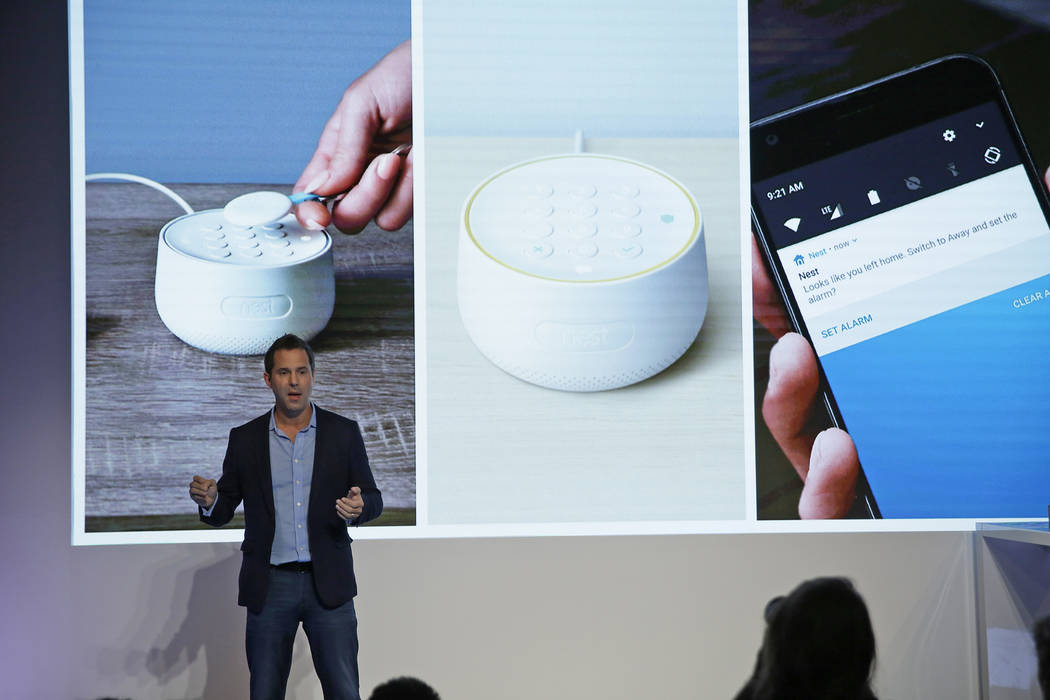 FILE - In this Wednesday, Sept. 20, 2017, file photo, Maxime Veron, head of product marketing for Nest Labs, talks about the features of the Nest Secure alarm system during an event in San Francis ...