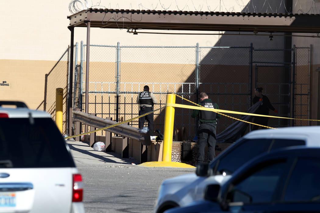 Las Vegas police investigate in the 2900 block of West Washington Avenue near Rancho Drive in Las Vegas Wednesday, Dec. 27, 2017. Metro homicide Lt. Dan McGrath said the victims were a homeless ma ...