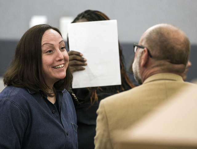 Kirstin Lobato, left, who has long claimed her innocence in a 2001 killing, talks to her attorney Travis Barrick in Regional Justice Center on Wednesday Jan. 04, 2017. The Innocence Project has ag ...