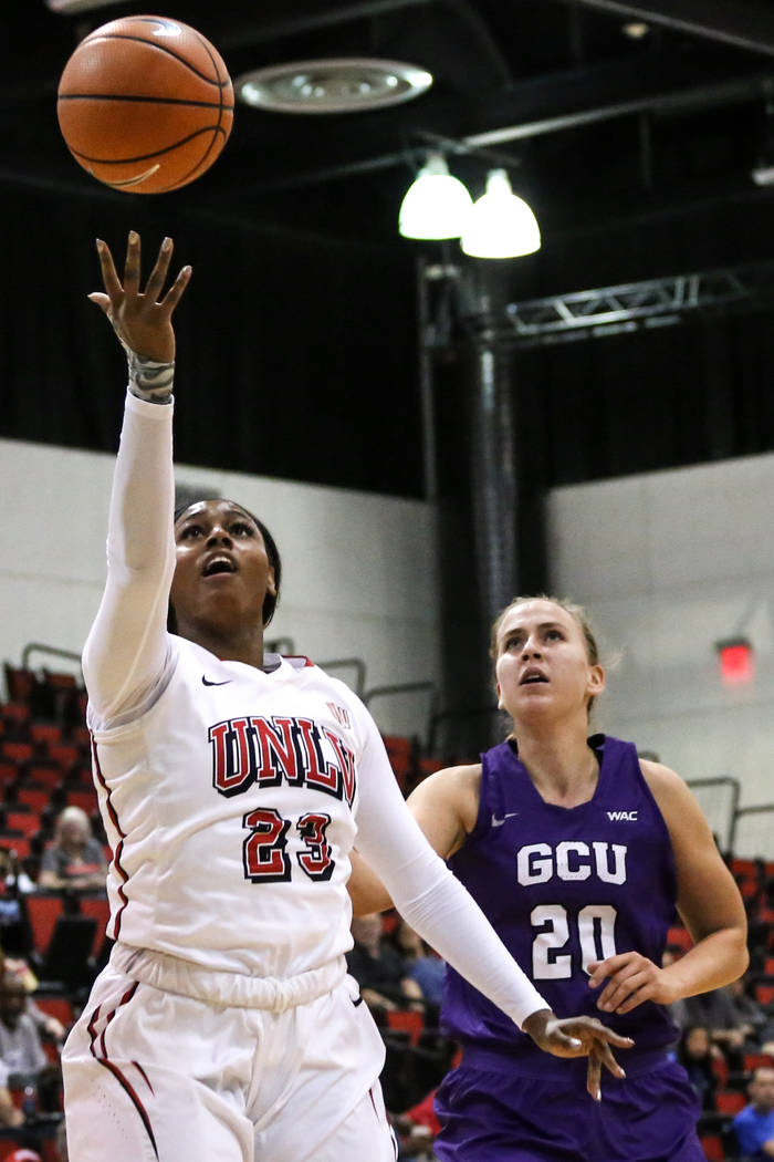 UNLV Lady Rebels forward Jordyn Bell (23), left, shoots the ball during third quarter of a basketball game against the Grand Canyon Antelopes at Cox Pavilion in Las Vegas, Sunday, Nov. 19, 2017. U ...