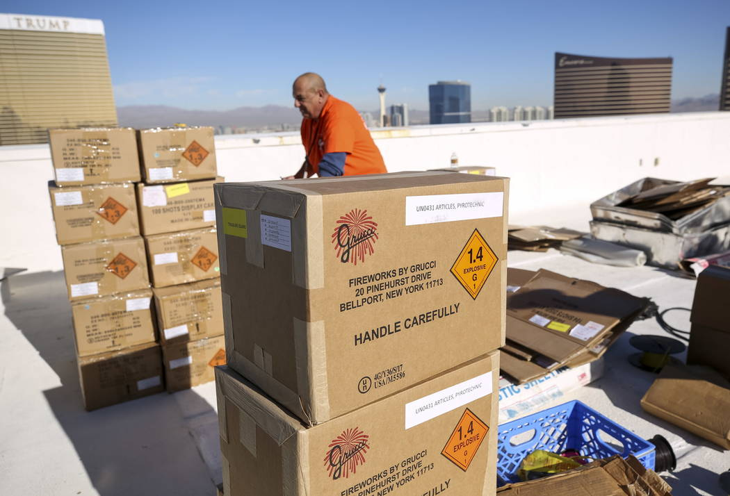 Fireworks by Grucci pyrotechnician Anthony Magno Sr. unpacks boxes of fireworks in preparation for the New Year's Eve fireworks show from the rooftop of Treasure Island on the Vegas Strip on Frida ...