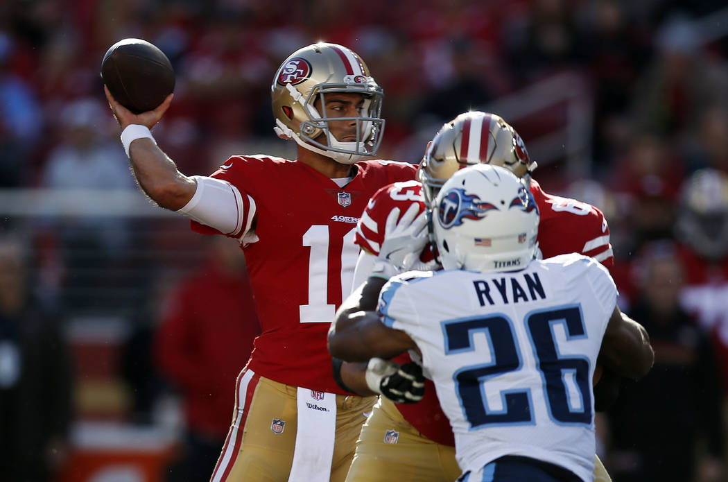 San Francisco 49ers quarterback Jimmy Garoppolo, left, throws against the Tennessee Titans during the first half of an NFL football game Sunday, Dec. 17, 2017, in Santa Clara, Calif. (AP Photo/D.  ...