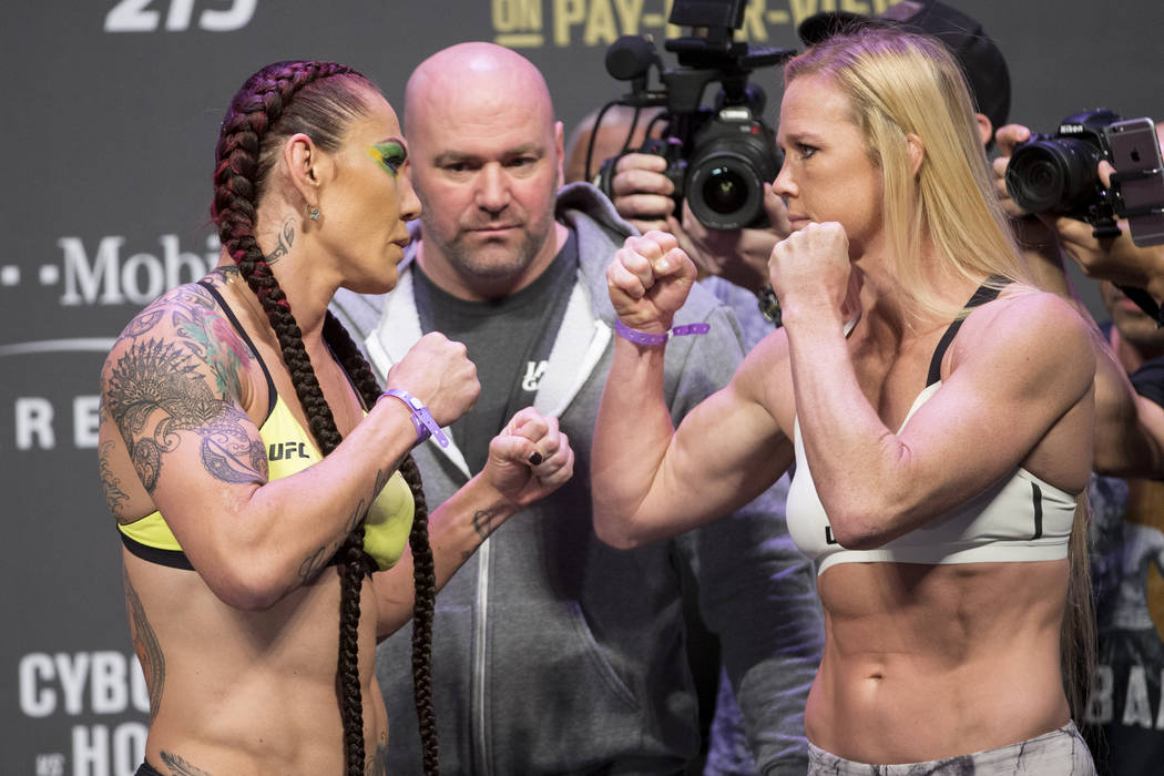"Cris ""Cyborg"" Justino, left, and Holly Holm during the UFC 219 ceremonial weigh-in event at T-Mobile Arena in Las Vegas, Friday, Dec. 29, 2017. Erik Verduzco/Las Vegas Review-Journal"