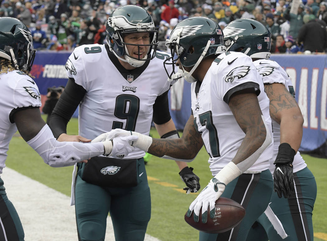 Philadelphia Eagles quarterback Nick Foles (9) celebrates with wide receiver Alshon Jeffery (17) after they connected on a touchdown pass against the New York Giants during the first half of an NF ...