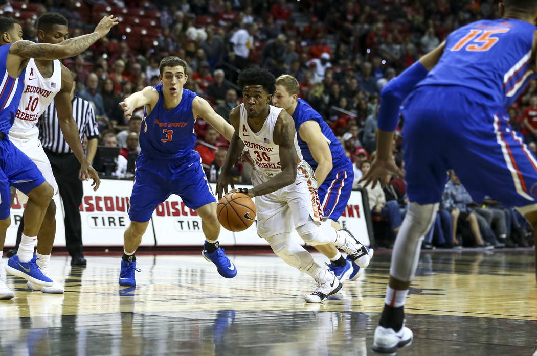 UNLV Rebels guard Jovan Mooring (30) drives the ball past Boise State Broncos during the first period of an NCAA college basketball game at the Thomas & Mack Center Saturday, Dec. 30, 2017, in ...